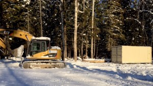 Foothills happily donating time setting seacan in place for the Fernie Nordic Society - Nordic Trails